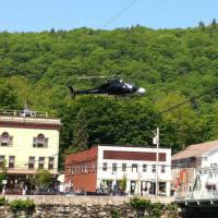 Helicopter flying over the village during the filming of The Judge